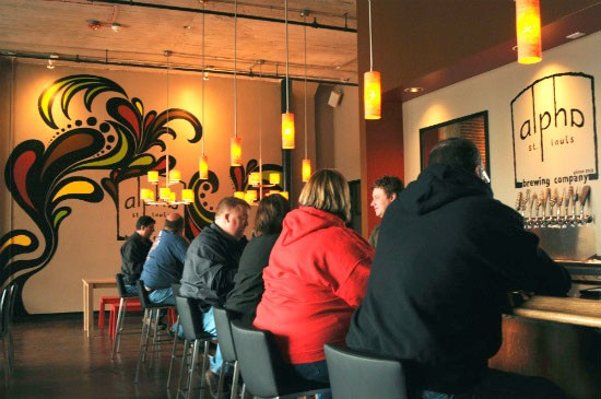Patrons sit at the bar at Alpha Brewing Company. - CAILLIN MURRAY