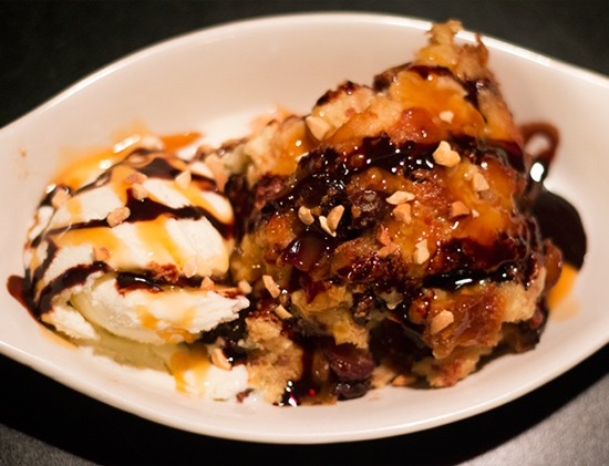 Don't forget dessert: Miss Leon's offers peach cobbler and this decadent croissant bread pudding.