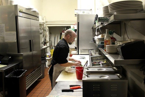Andrew Ladlie in the very small Sassy JAC's kitchen | Kaitlin Steinberg