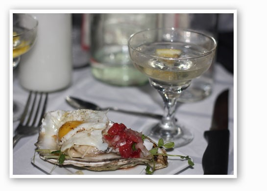 The second course was oysters topped with a quail egg. | Nancy Stiles