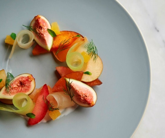 Stone fruit and fig salad with cardamom-orange blossom yogurt. | Greg Rannells