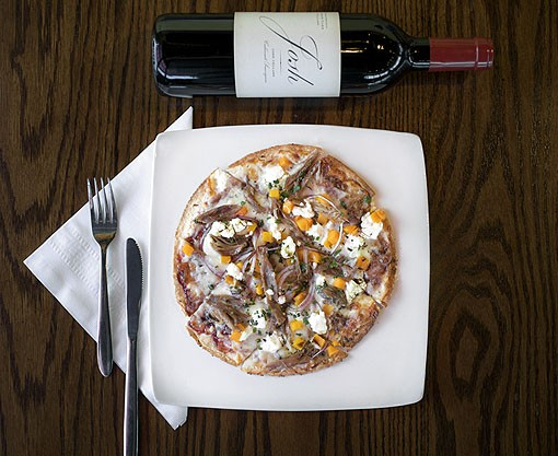 "There are also four flatbreads featured on the menu, one of which is the Duck Confit Flatbread. It is made with a raspberry chipotle ""sauce,"" butternut squash and goat cheese. It is shown here with a Josh Cellars Cabernet Sauvignon. View the full slideshow here. - PHOTO: JENNIFER SILVERBERG"