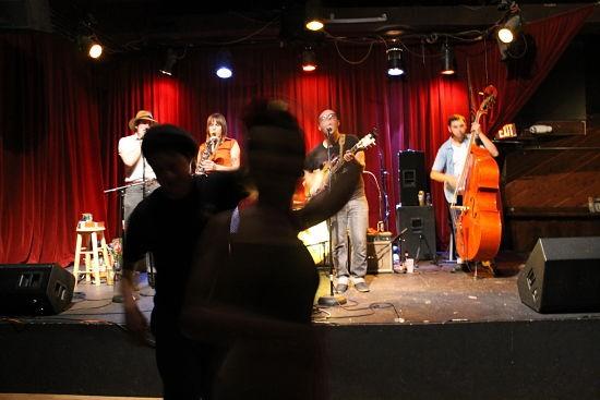 Swing dancers twirl to Rum Drum Rambler's set. - CASSIE KOHLER