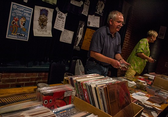 The merch table at Skin Graft Homecoming 2013 included posters and CDs from Johnson's personal collection. - MABEL SUEN