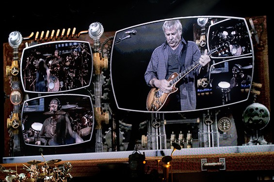 Rush's Alex Lifeson, highlighted in the center. More photos here. - TODD OWYOUNG