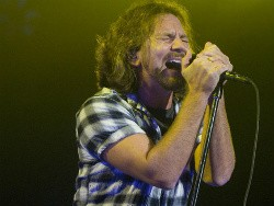 Eddie Vedder with Pearl Jam at the Scottrade Center last year. - JON GITCHOFF
