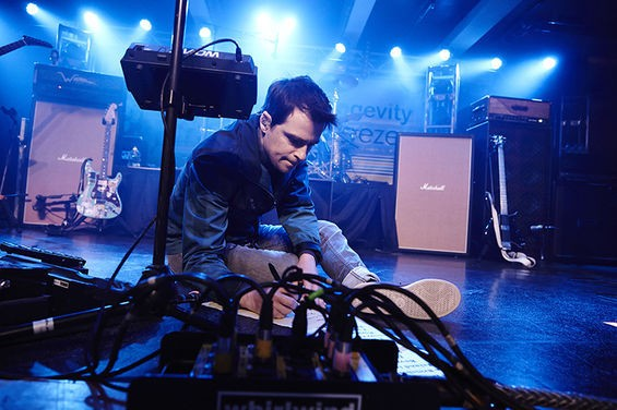 Rivers Cuomo makes some notes before the Weezer show at Plush. See more photos here. - STEVE TRUESDELL