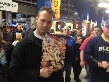 Jeremy Stein -- a member of Waco's television media -- holds a program that he purchased at the Royal Rumble. - JASON ROSENBAUM