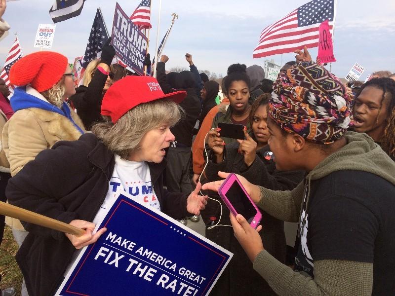 Trump supporters and critics debate outside a campaign rally in November 2017. - DANIEL HILL