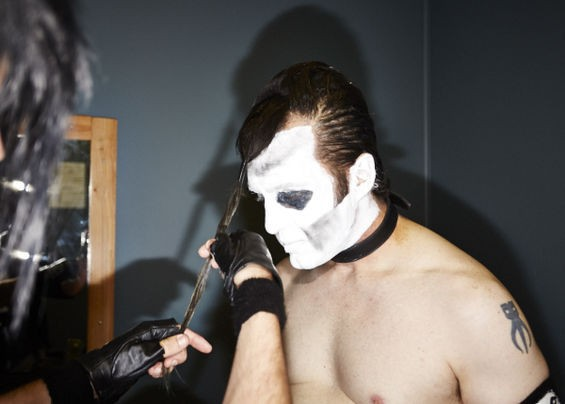 "Band members attach extra hair to guitarist Wade Durbin's [stage name Durbin Wolfgang Von Frankenstein] head, helping him achieve Doyle's twisted ""devilock."" - THEO WELLING"