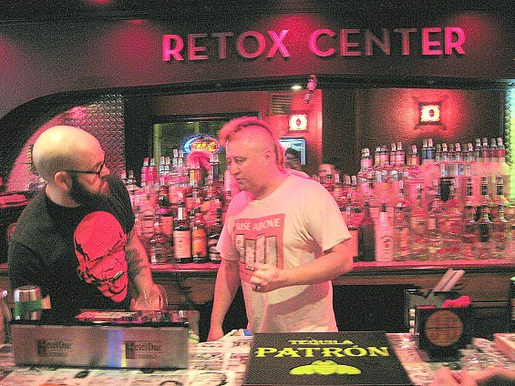 "Silver Ballroom owner Steve ""Doc"" Dachroeden tending bar with Justin. - DIANA BENANTI"