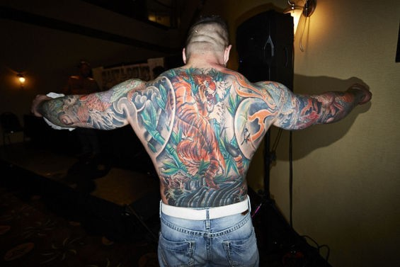 It's like a beautiful rainbow volcano exploded on his back. See more photos here. - THEO WELLING