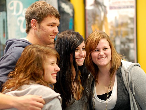 Valerie Anne Poxleitner, aka Lights (second from right) mingles with fans in Suite 100 adjacent to the Pageant. Lights was due to open the concert. - PHOTO: JASON STOFF