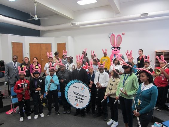 Mr. Nowden's class shows off their $30,000 check from VH1 and Energizer. - DIANA BENANTI