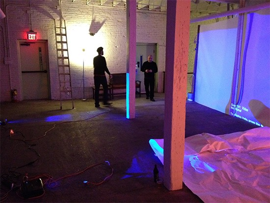 Visual artists Chad Eivens and Kevin Harris prep for the show this Thursday by setting up giant screens for full-color video projections. - COURTESY OF JEREMY KANNAPELL