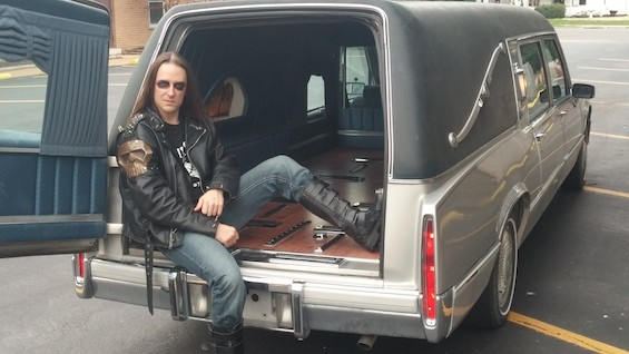 We Bite bassist Nikki Strychnine is dead serious about his new ride -- a 1990 Cadillac de Ville hearse. - NIKKI STRYCHNINE