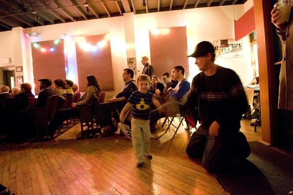 Dave Stein of U. City and son Gabriel, 3, dance during the seventh-annual Rough Shop Holiday Extravaganza at the Focal Point - KHOLOOD EID