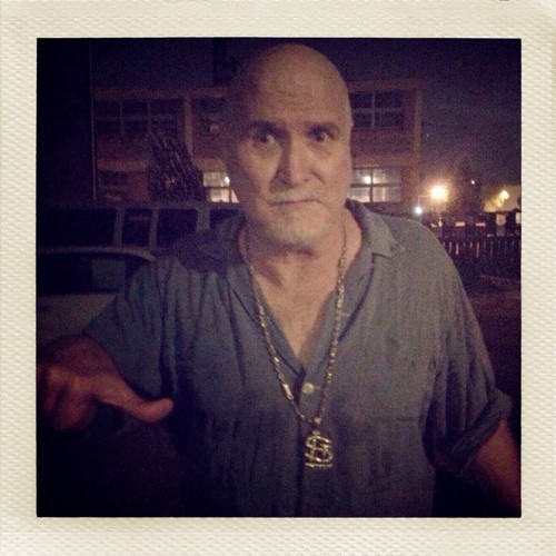 Bob Reuter giving a partial thumbs-up outside Off Broadway in 2011. (He was unsure how to feel about being forced to wear my STL bling necklace.) - PHOTO BY JAIME LEES