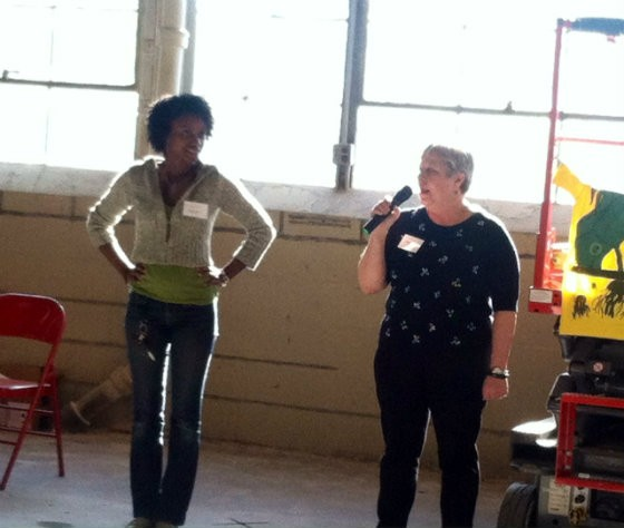 ArtWorks executive director Priscilla Block (right) with Stajah Curry. A former apprentice in the program, Curry is now a teacher for it. - PHOTO BY SARAH FENSKE