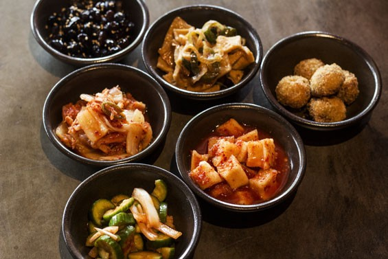 Sides at Seoul Q include an array of kimchi, beef croquettes and sweet black beans. - MABEL SUEN