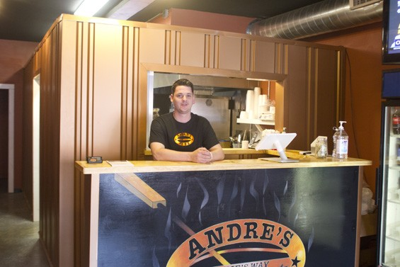 Dean Johnson, shown here manning the counter at Andre's Ribs, is the restaurant's manager -- and Julie Edwards' son. - PHOTO BY SARAH FENSKE