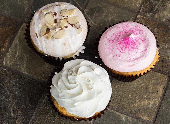 A selection of Smallcakes' sweets: bear claw, pink vanilla and wedding cake flavors. | Photos by Mabel Suen