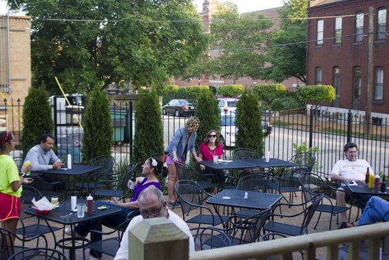 The patio is bare-bones, but an easy place to snag a seat on a warm summer night. - PHOTO BY SARAH FENSKE