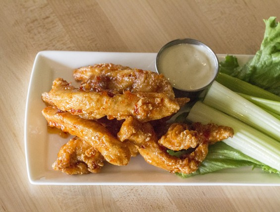 """Sweet Chili Boneless Wings"" with blue cheese dressing. 