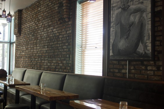A high banquette replaces the booths that previously lined the walls at Luvy Duvy's. - PHOTO BY SARAH FENSKE