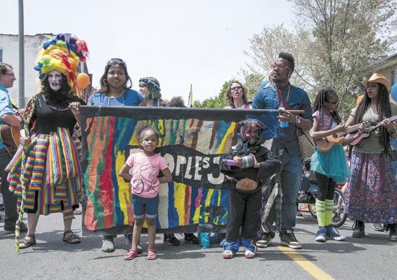 Marchers on Cherokee Street. - MICAH USHER