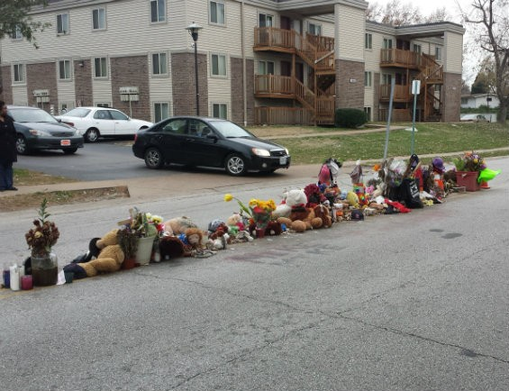 The weather-worn memorial on Canfield Drive, November 11, 2014. - JESSICA LUSSENHOP