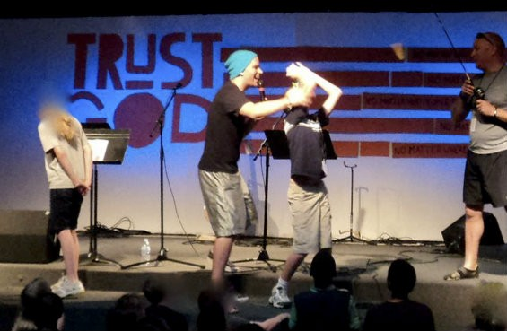 In this June 2012 photo, Brandon Milburn can be seen on the FCCF main stage directing middle school and teen boys during the annual Vacation Bible School. Milburn was allowed to attend FCCF youth events, even though a parent says she warned the church's lead pastor about Milburn four months prior.