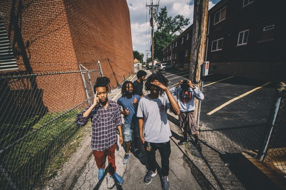 Five of the six members of MME -- a hip-hop collective making big waves through its music in the post-Ferguson era. - PHOTO BY COREY MILLER