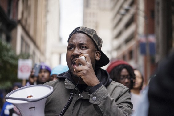 St. Louis rapper and activist Tef Poe leads a march through downtown St. Louis on October 11, 2014. - PHOTO BY BARRETT EMKE