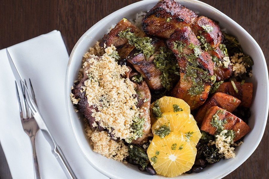 Feijoada, a traditional Brazilian dish, brims with beans, rice, oranges and various cuts of beef and pork. - MABEL SUEN
