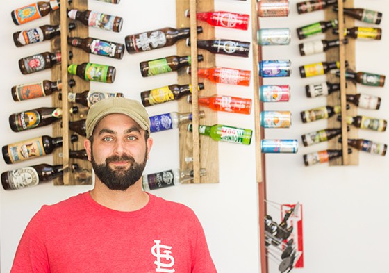 Co-owner Brendon Maciariello in front of the restaurant's extensive bottle selection.