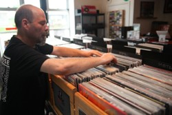 CARL DANIELS FLIPS THROUGH THE VINYL STACKS