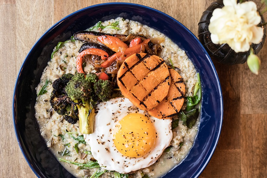 A new lunch offering, a quinoa bowl, includes broccoli, sweet potato, roasted onions and zucchini, topped with an egg. - MABEL SUEN