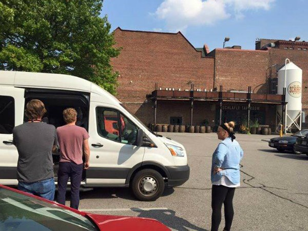 The band outside Schlafly Tap Room, contemplating their missing equipment. - PHOTO BY COLIN PERKINSON