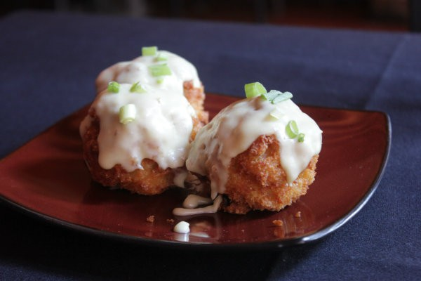 Mac and cheese bites are breaded in panko and fried, with a creamy sauce on top. - PHOTO BY SARAH FENSKE