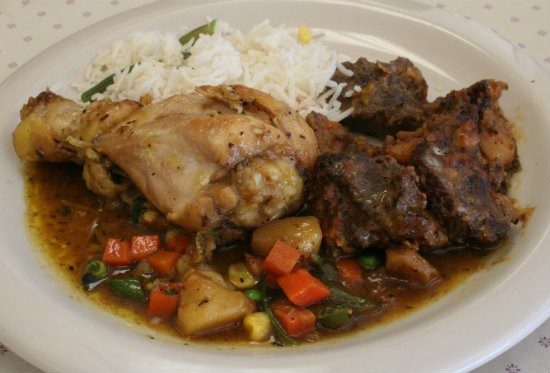A plate from the buffet, which included roasted goat and chicken curry with rice - PHOTO BY JOHNNY FUGITT