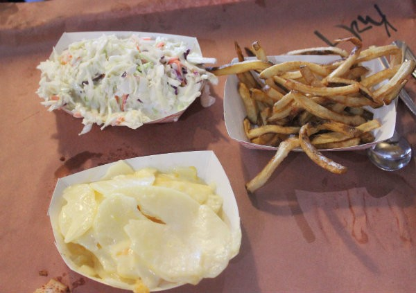 From top: Coleslaw, fries and a three-cheese potato gratin special at Sugarfire. - PHOTO BY LAUREN MILFORD