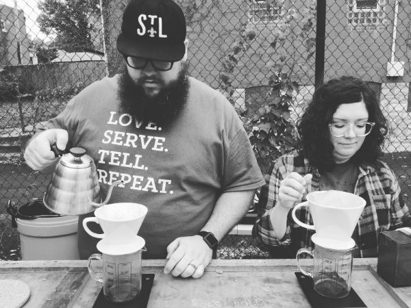 Josh and Kim Jones brewing coffee.