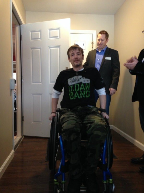 Chris Sanna enters his House Springs home for the first time since he was shot in September 2015 in downtown St. Louis. - DOYLE MURPHY