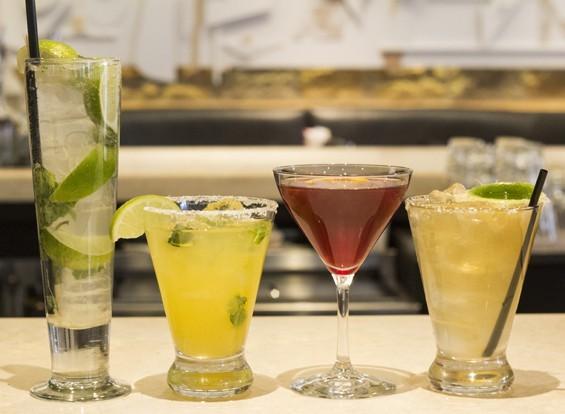 """Cantina Laredo's mojito, """"Ginger Mint Mango Rita,"""" """"Aphrodite Rita"""" and """"Cabo Flip."""" - PHOTO BY MABEL SUEN"""
