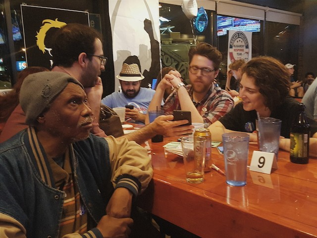 Supporters at Bernie Sanders' watch party in downtown St. Louis monitor election returns. - PHOTO BY DANNY WICENTOWSKI