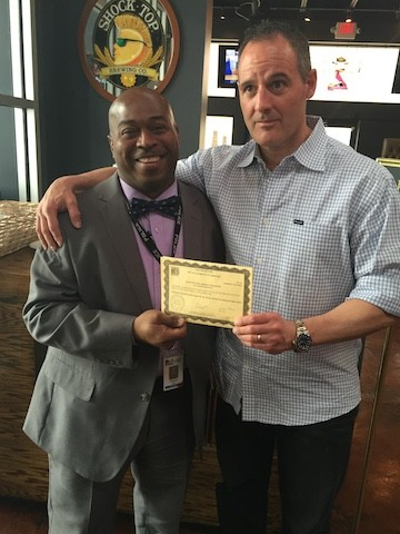 John Racanelli, owner of Social House II, gets his liquor license returned to him by a University City staffer. - PHOTO COURTESY OF JOHN RACANELLI