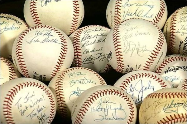 Jack Buck encouraged John to learn how to write again by sending him signed baseballs. - PHOTO COURTESY OF THE O'LEARY FAMILY