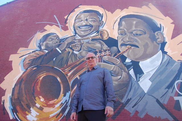 Artist Ray Harvey in front of his mural. - PHOTO BY HARLAN MCCARTHY