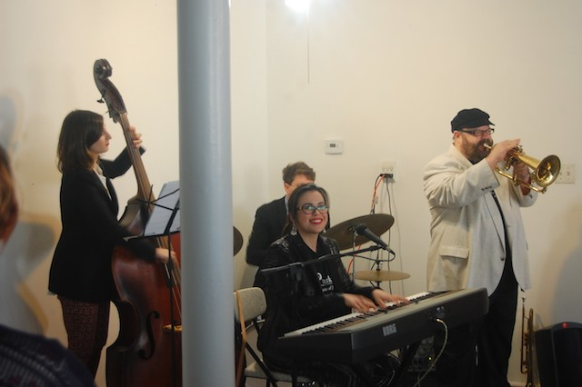 The band at the mural unveiling featured Stephen Fulton (on the flugelhorn) Champian Fulton (vocals and piano), Ben Zweig (drums) and Adi Meyerson (bass). - PHOTO BY HARLAN MCCARTHY